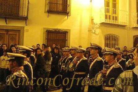 La Banda de Cornetas y Tambores Monte Calvario de Martos acompañando a la Hermandad del Huerto de Torredonjimeno